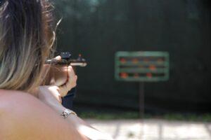 woman aiming gun
