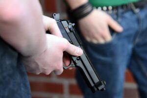 gun owner with pistol